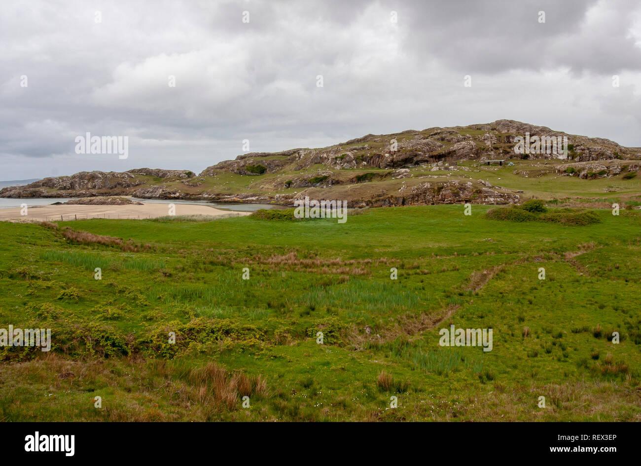Rocks and land on the coast of County Mayo, Ireland. - Stock Image