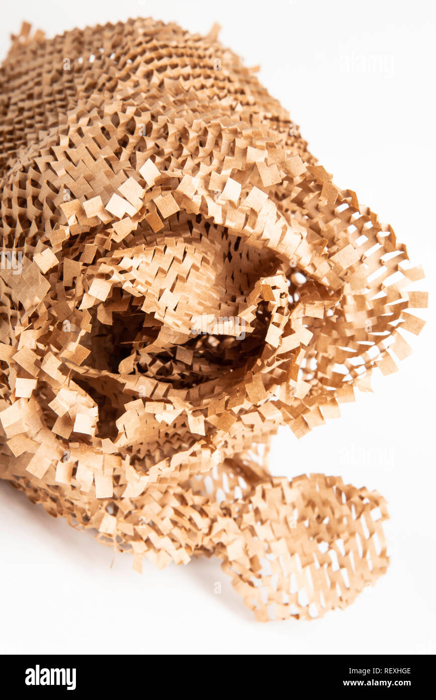 A bunched up and crumpled recyclable brown paper filler and packaging material. - Stock Image