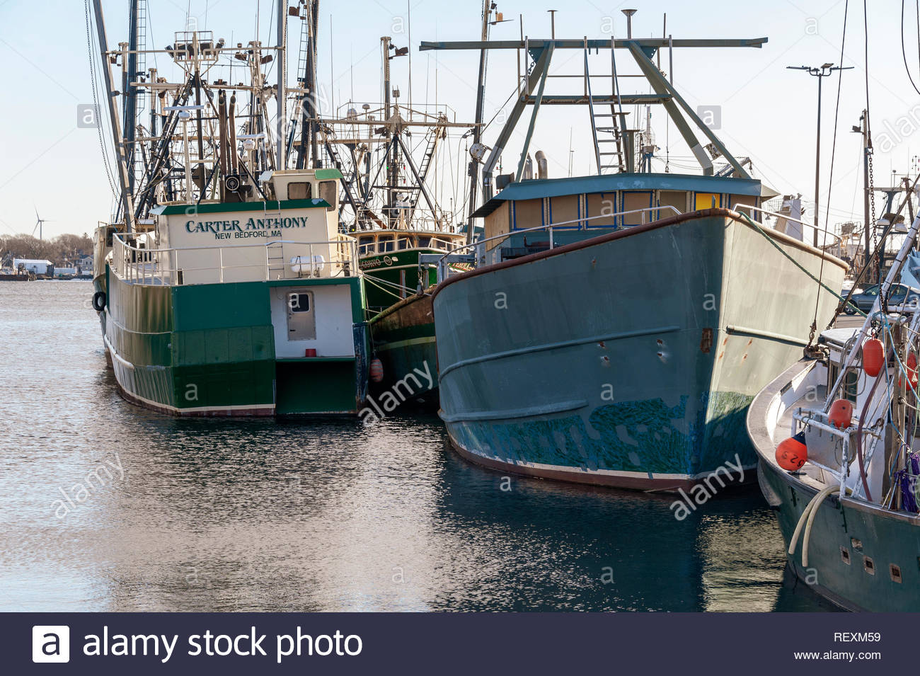 New Bedford, Massachusetts, USA - January 12, 2019: Cluster of commercial fishing vessels along New Bedford wharf - Stock Image