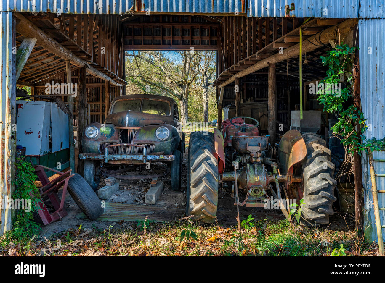 Old Farm Tractor in Old barn - Stock Image