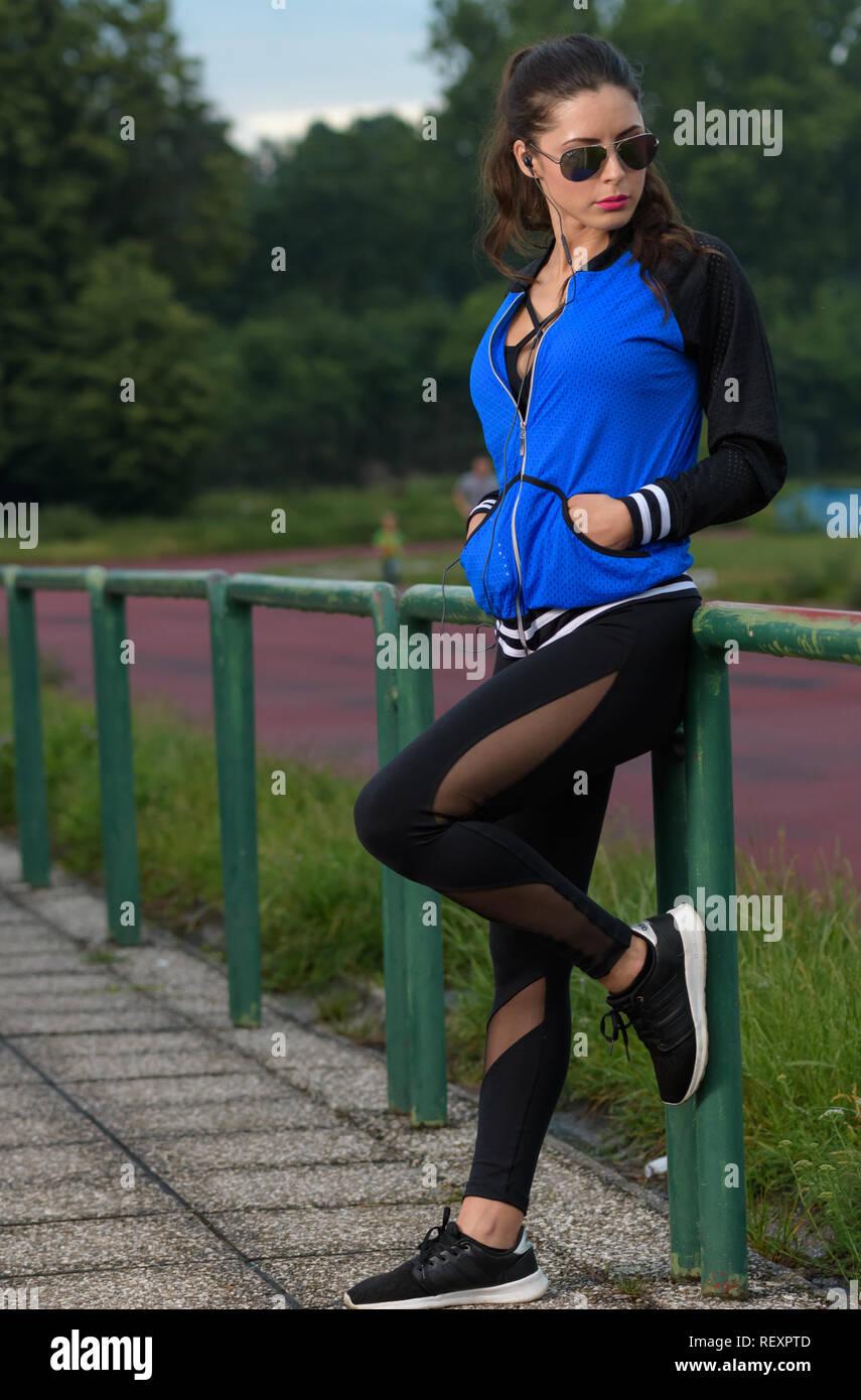 woman posing on athletics track in sportswear Stock Photo