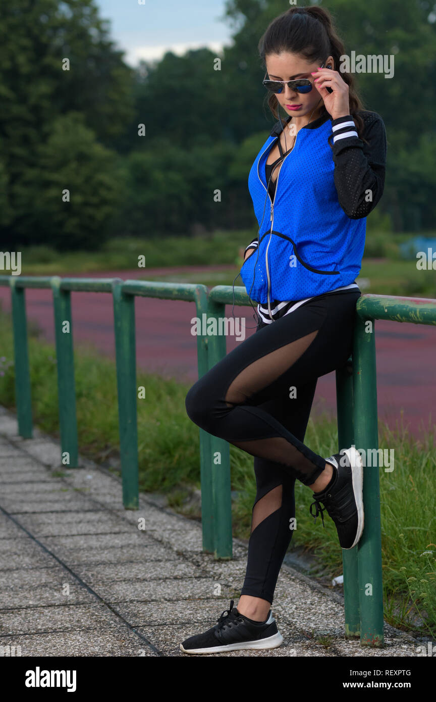 woman posing on athletics track in sportswear Stock Photo