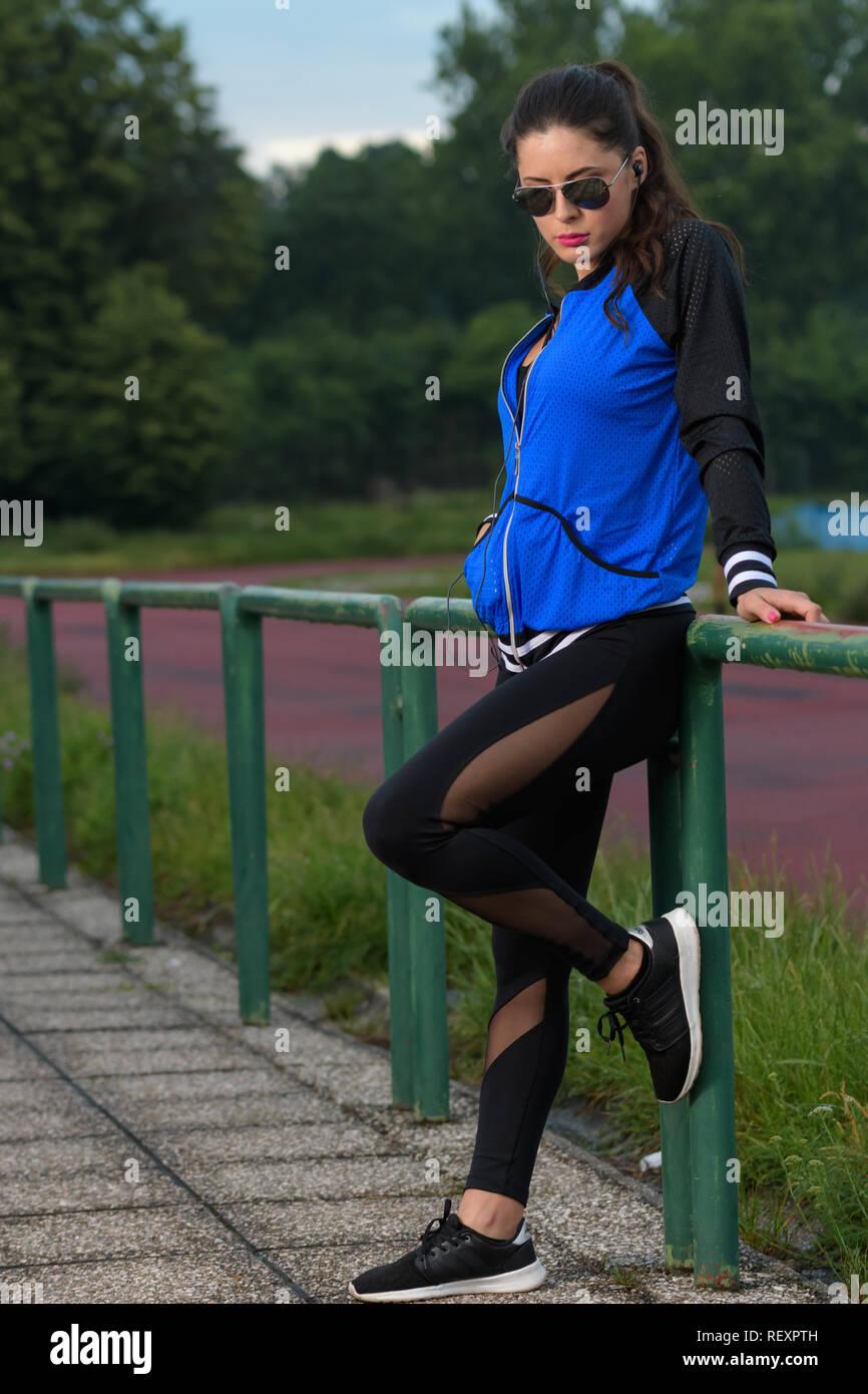 fitness girl posing on athletics track Stock Photo
