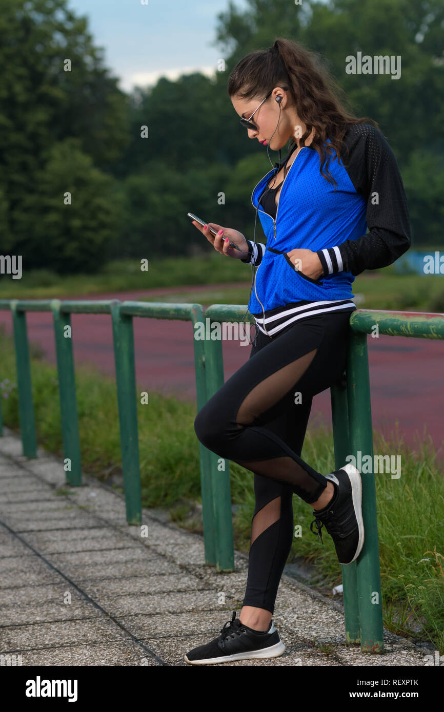 girl in sportswear on Athletic track Stock Photo