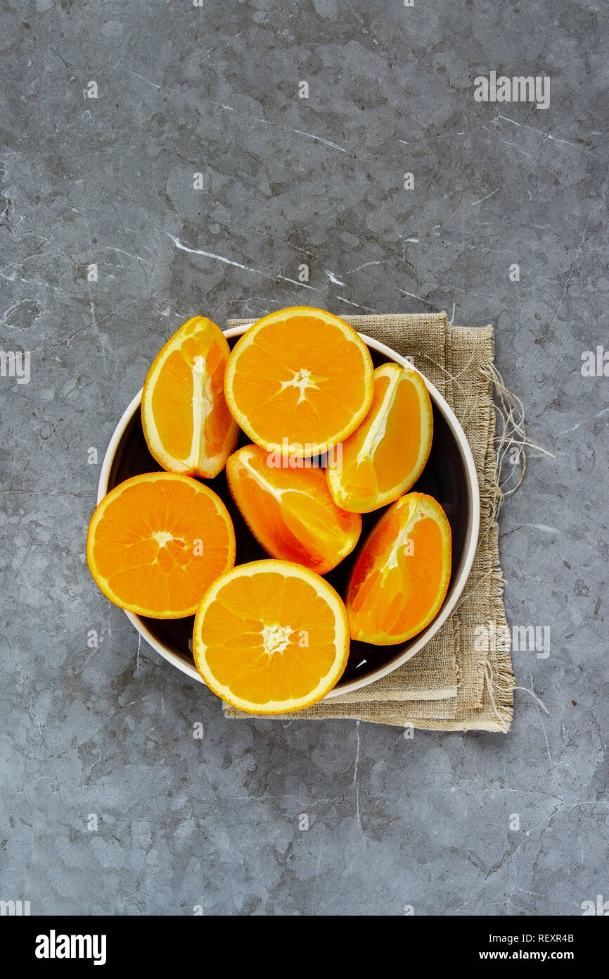 Sliced orange on plate flat lay top view - Stock Image