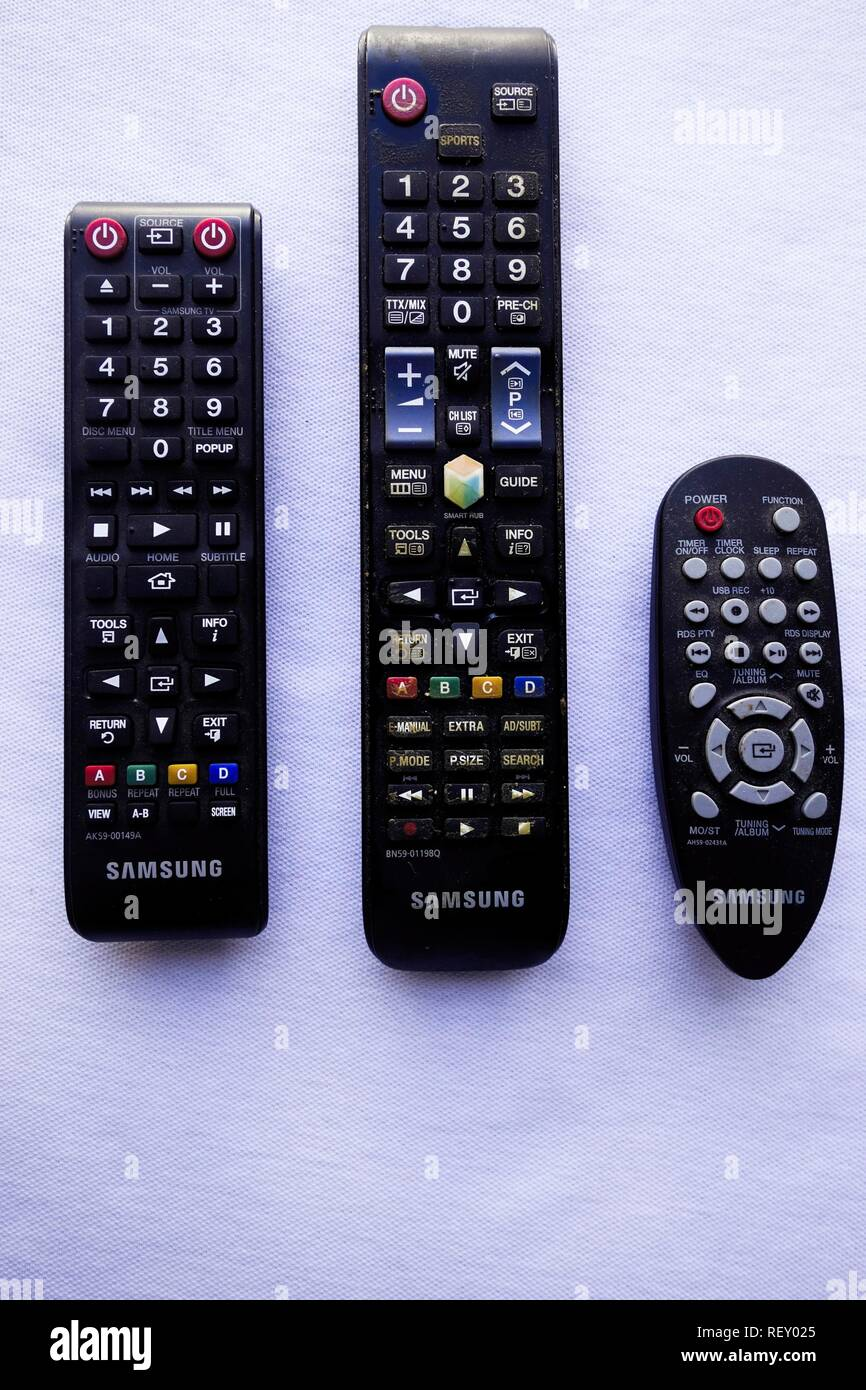 TV, Blu ray and Hi-Fi System Remote Controls Isolated on White - Stock Image