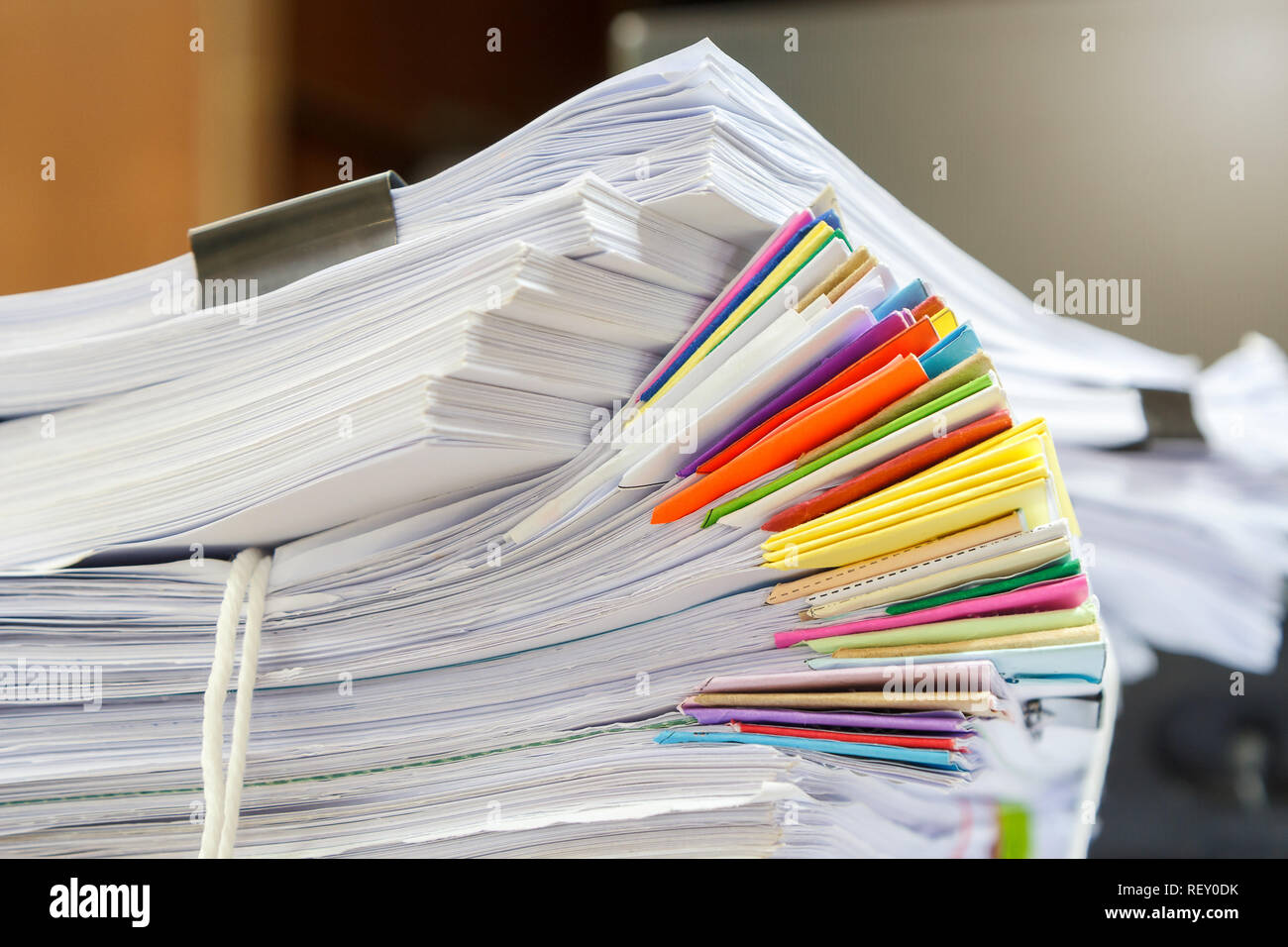 Close up of business documents stack on desk , report papers stack - Stock Image