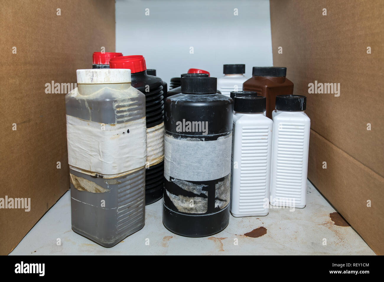 Flammable dangerous chemical in plastic bottle containers on a shelf in the lab - Stock Image