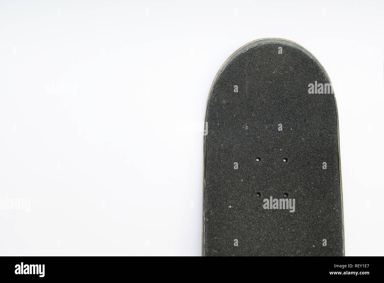 b2df77f3 Front top of a skateboard deck with grip tape and bolt holes on white  background -