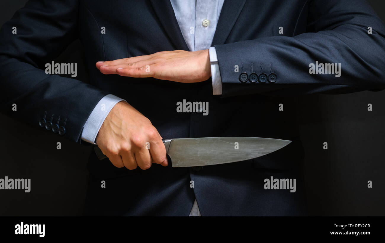 Criminal with big knife hidden. Cold weapon, burglary, homicide, murder scenery - Stock Image