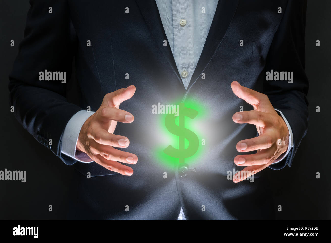 Controlling money concept. Currency symbol - dollar sign between human hands. Money making and wealth - Stock Image