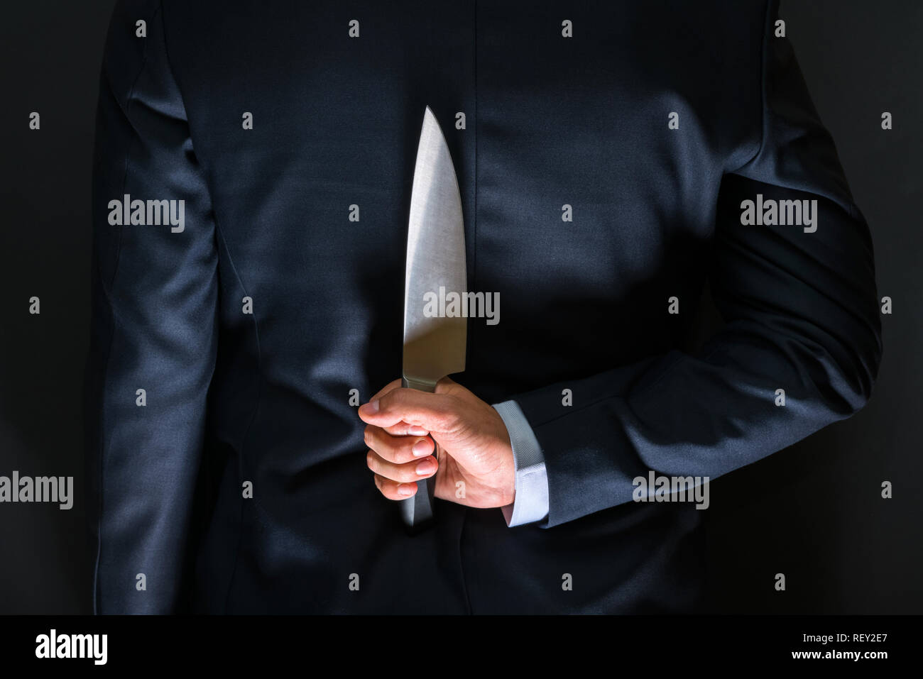 Robber with big knife - a killer person with sharp knife about to commit a homicide, murder scenery - Stock Image
