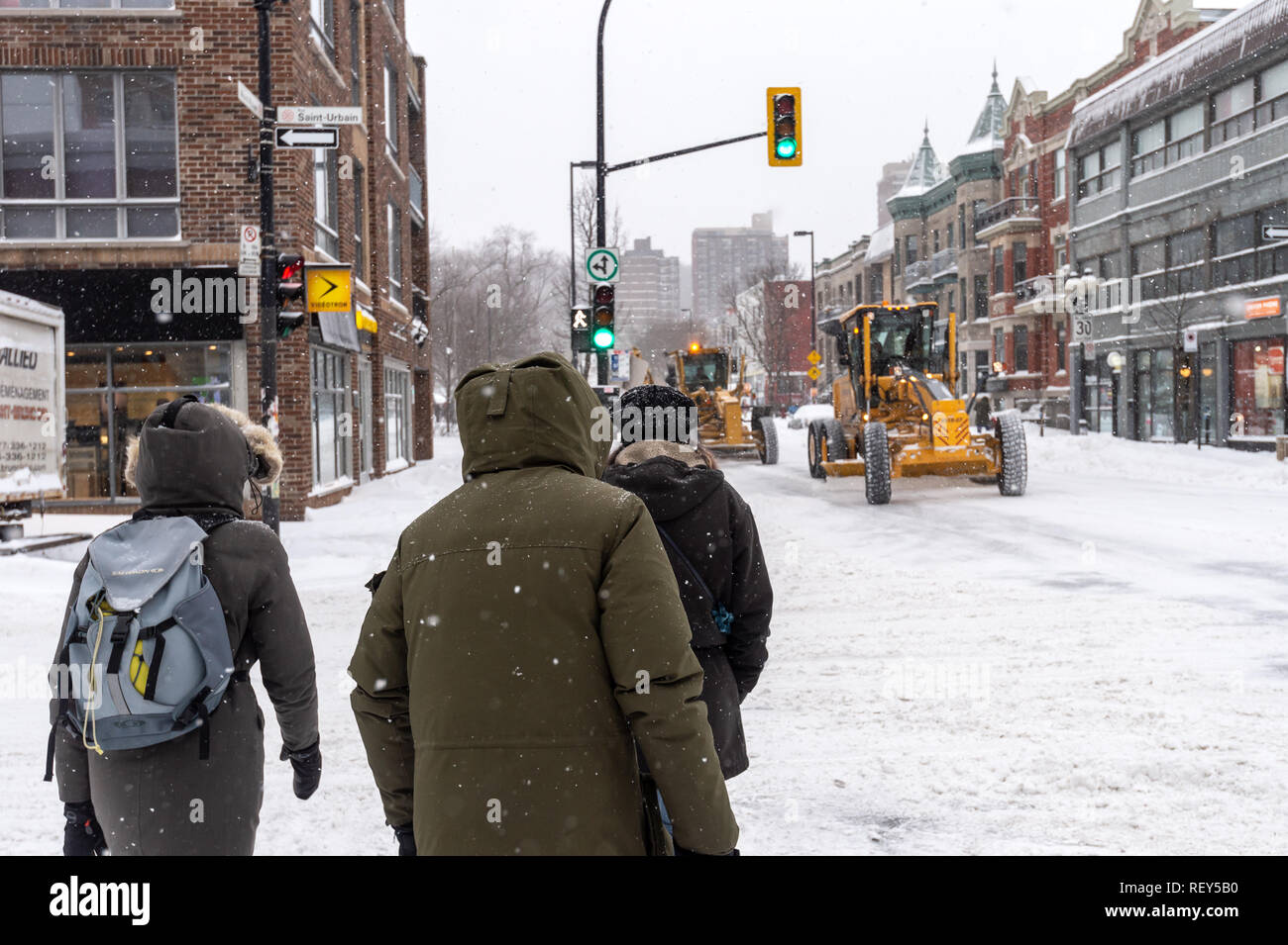 Montreal, Canada - 20 January 2019: Pedestrians walking on Mont-Royal Avenue during snow storm Stock Photo