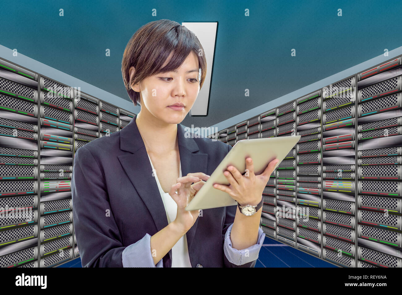 Asian IT network engineer in server room - Stock Image