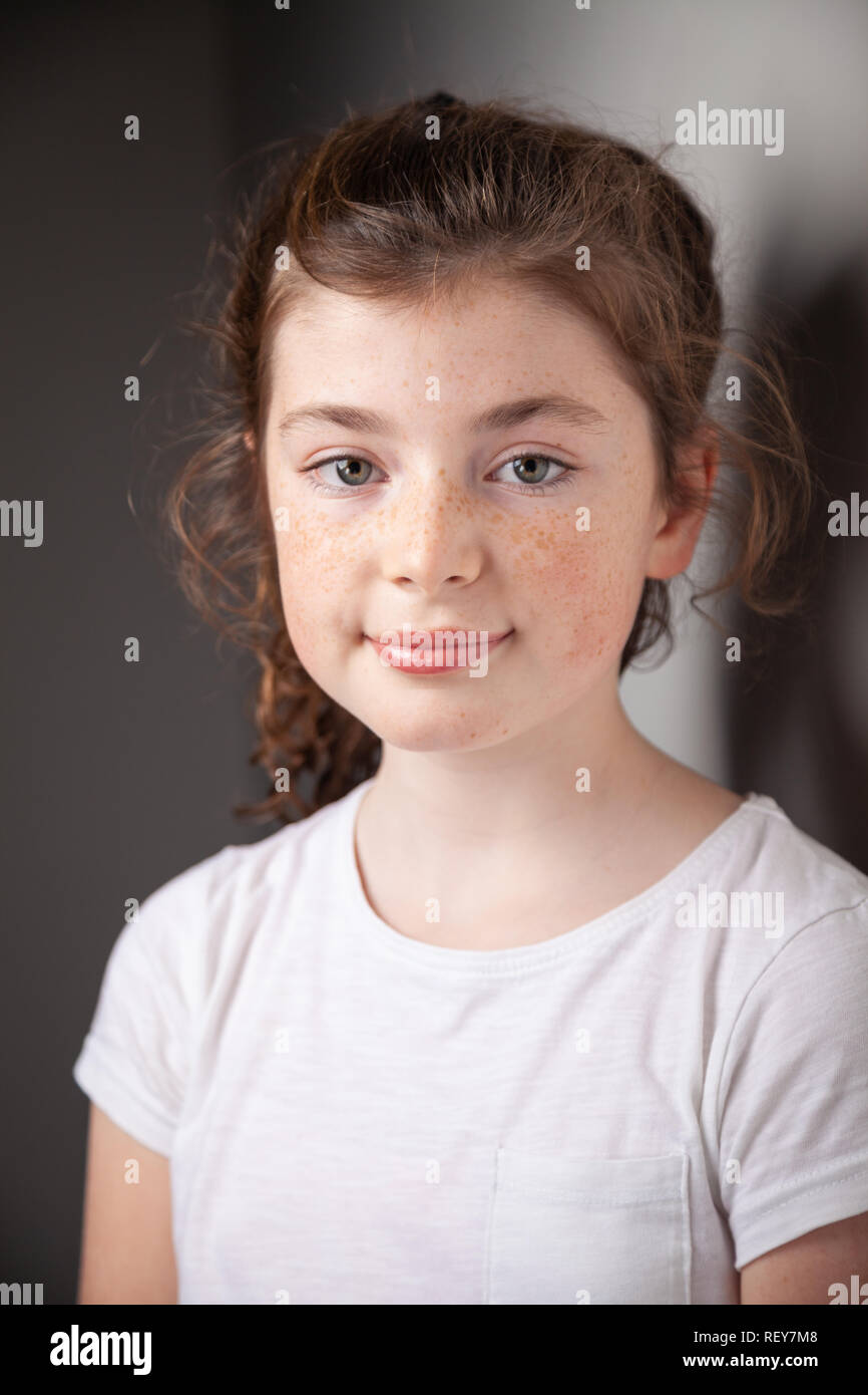 Portrait of pretty Scottish 10 year old girl with freckles. - Stock Image