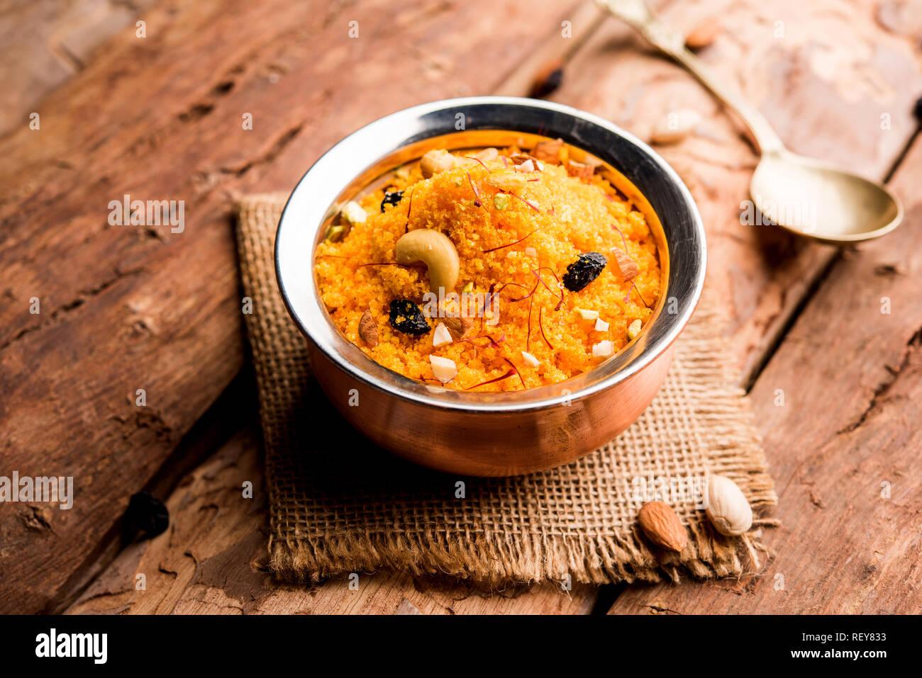 Badaam kesar shira / Sheera or almond saffron halwa, popular Indian dessert served in a bowl. selective focus - Stock Image