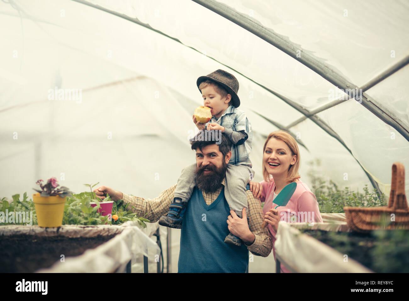husbandry with happy family. happy family keep husbandry. husbandry with happy family in greenhouse. husbandry with happy family having farm business - Stock Image