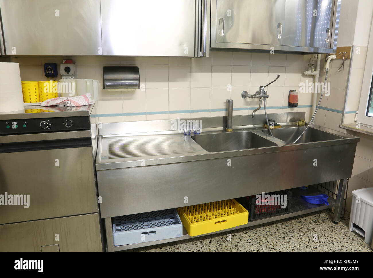 Stainless Steel Furniture Of A Large Industrial Kitchen With