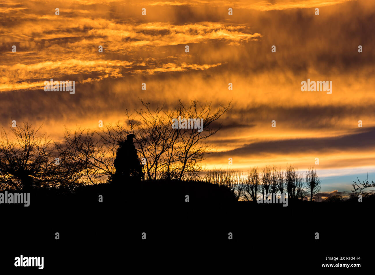 The clear air and the Devon hills seem to generate wonderful sunsets. - Stock Image