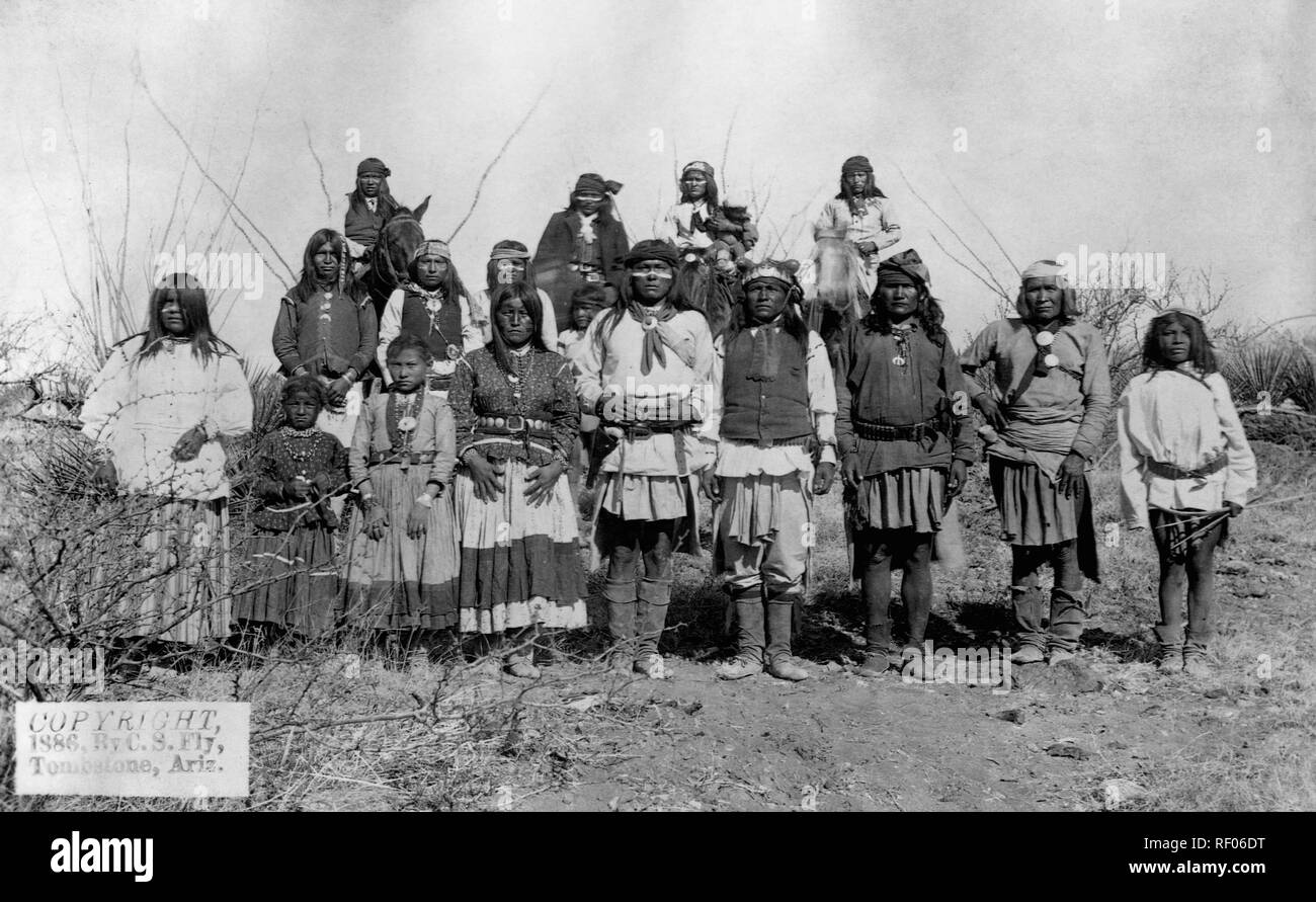 USA --- Geronimo (1829-1909), the Apache Chief that lead resistance to U.S. policy to consolidate his people on reservations stands with other Apache warriors, women and children shortly before his surrender to General Crook, March 27, 1886. --- Image by © CORBIS - Stock Image