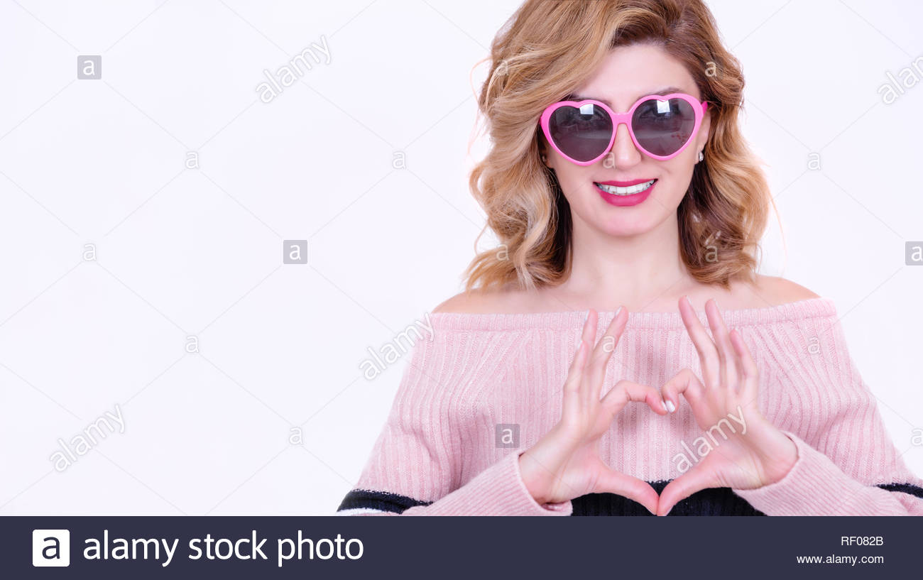 b6238b8add60 Beautiful model Girl in heart shaped sunglasses makes heart shape.Concept  image with isolated on