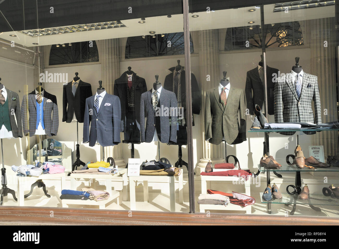 Stylish menswear suits and jacket combinations in shop window display, London, England, UK - Stock Image