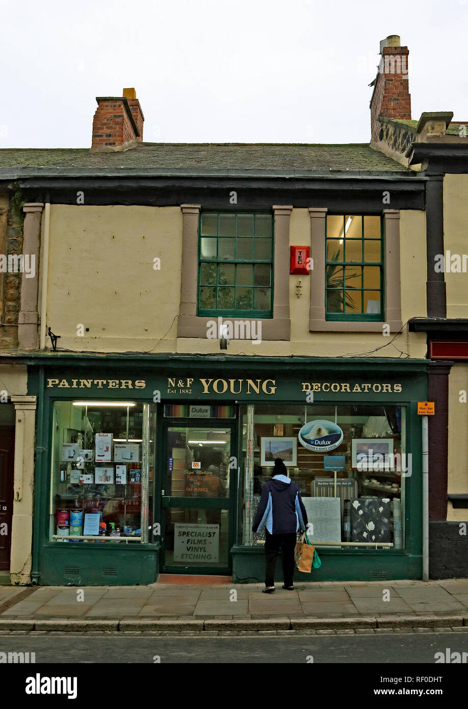 N and F Young painters and decorators high street shop Amble  Amble is a small town on the north east coast of Northumberland in North East England. - Stock Image