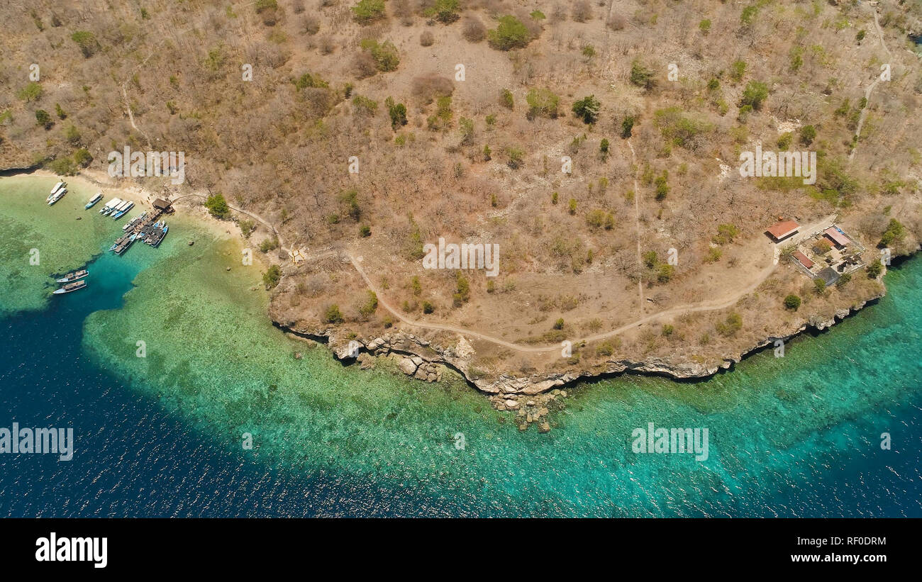 coastline island with coral reef, beach. Coral reef, atoll on Menjangan, colorful reef and perfect snorkeling and scuba diving. Seascape, ocean and beautiful beach paradise. Travel concept. - Stock Image