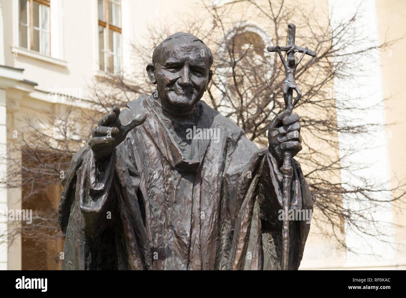Trnava, Slovakia. 2018/4/12. A metal statue of Saint John Paul II in front of the Saint John the Baptist Cathedral. - Stock Image