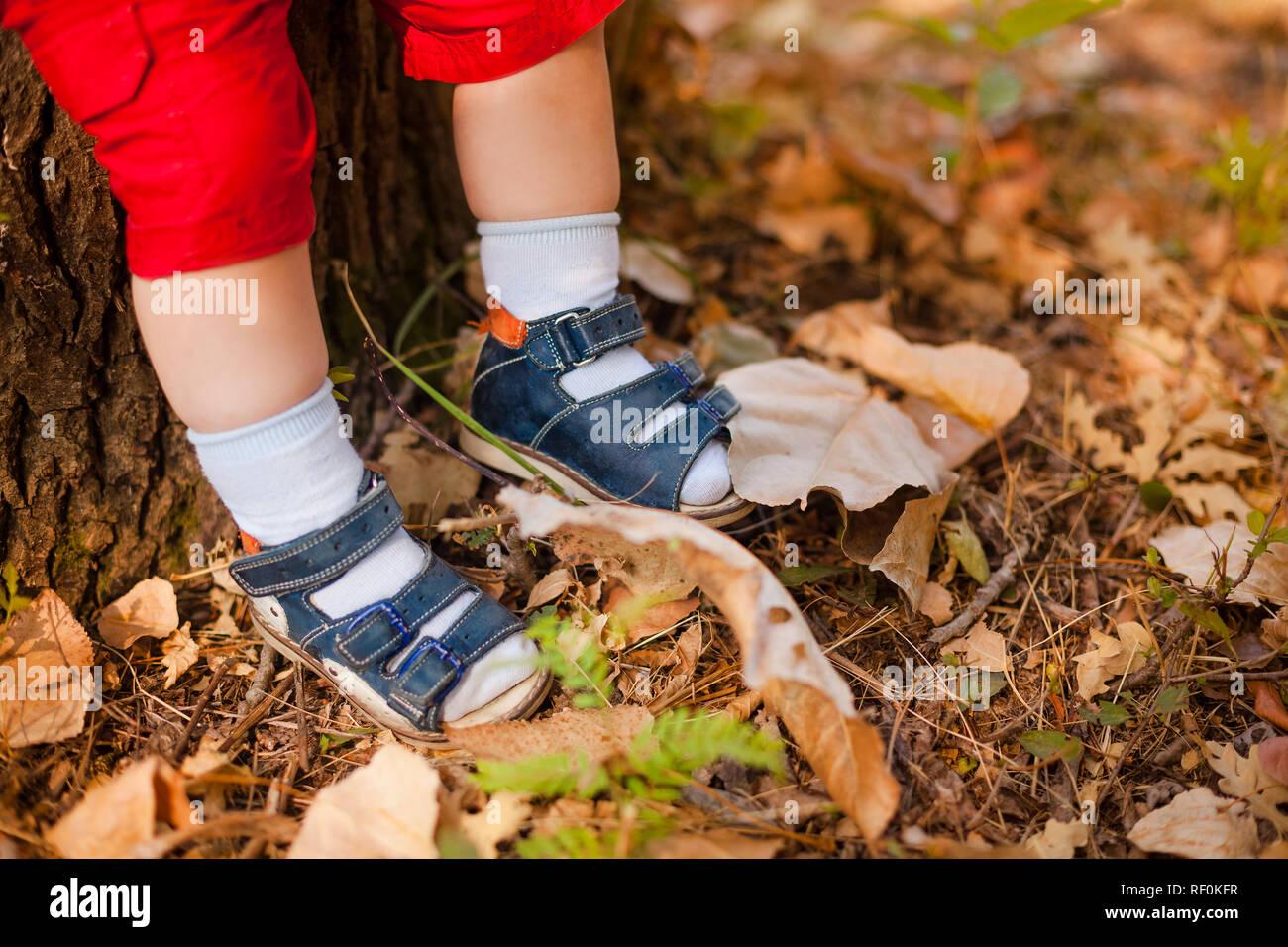 tiny baby feet in boots Stock Photo