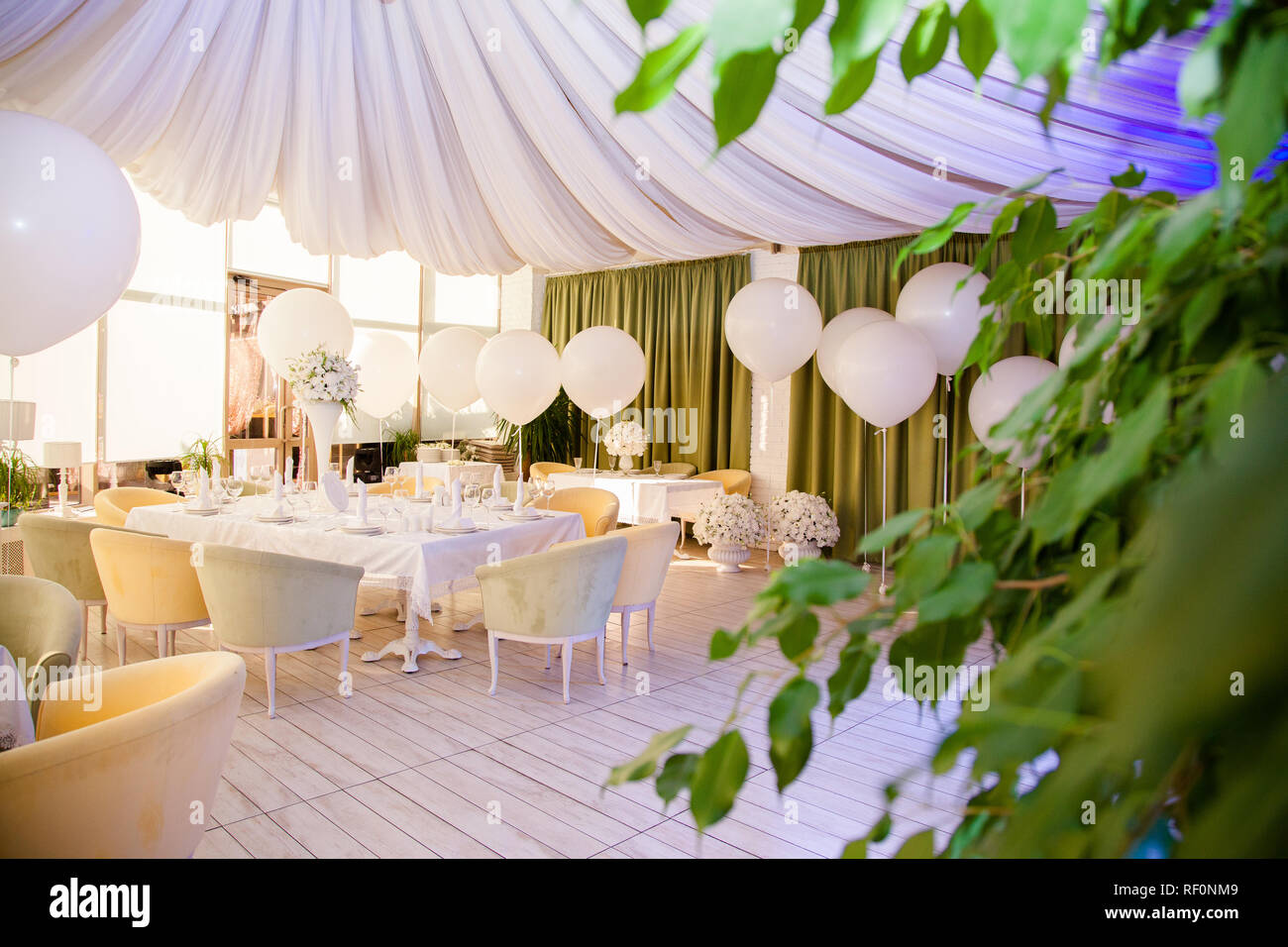 Wedding decor. Wedding tables in restaurant with white