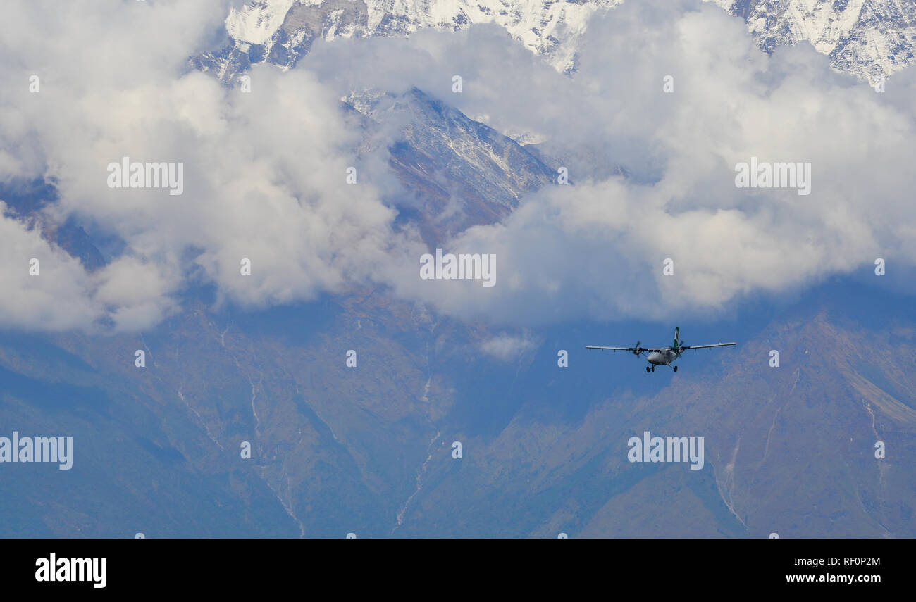 Khopra, Nepal - Oct 25, 2017. A passenger airplane flying over the mountains of Annapurna Massif, Nepal. - Stock Image