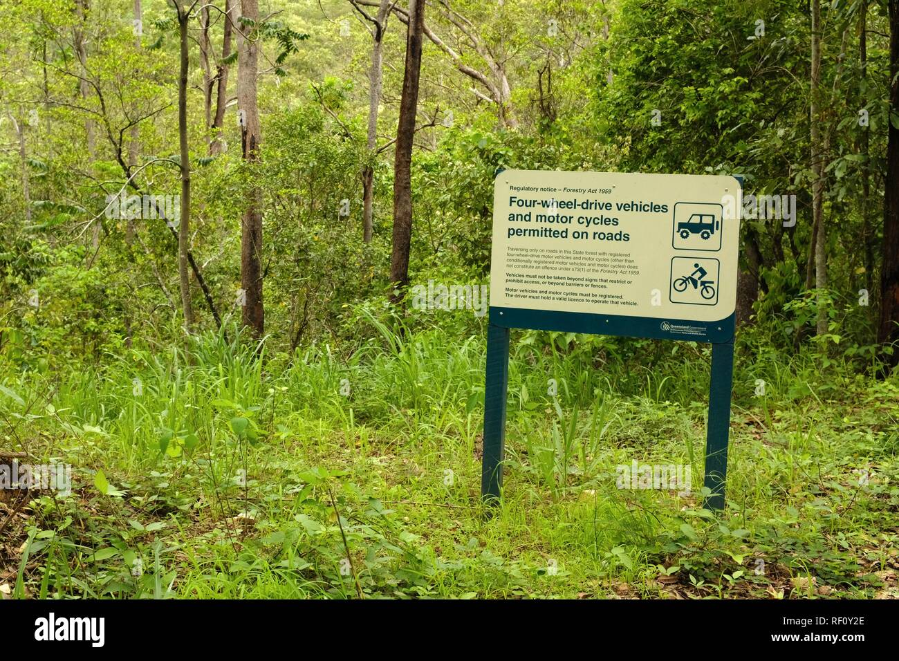 Four wheel drive vehicles and motor cycles permitted on roads sign, Mia Mia State Forest, Queensland, Australia - Stock Image