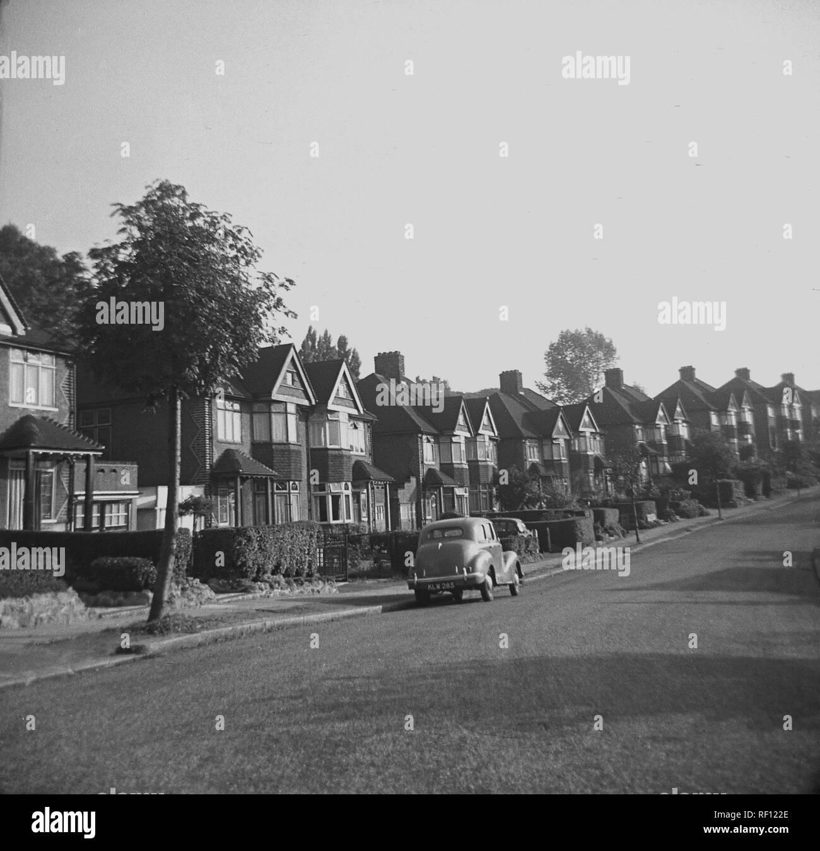 1940s, historical, motorcar parked in suburban street, England, UK - Stock Image
