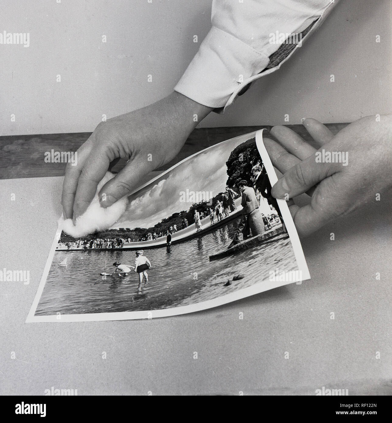 1950s, historical, photography, wiping a new print produced from the photographic film negative. - Stock Image