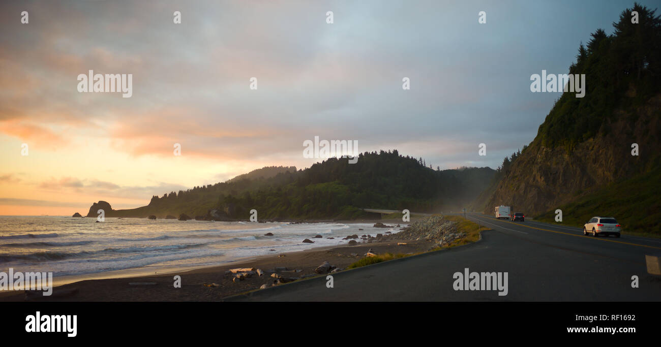 Highway 101 is a scenic coastal route through Northern California, seen here at sunset from a roadside beach on the Pacific Ocean. Stock Photo