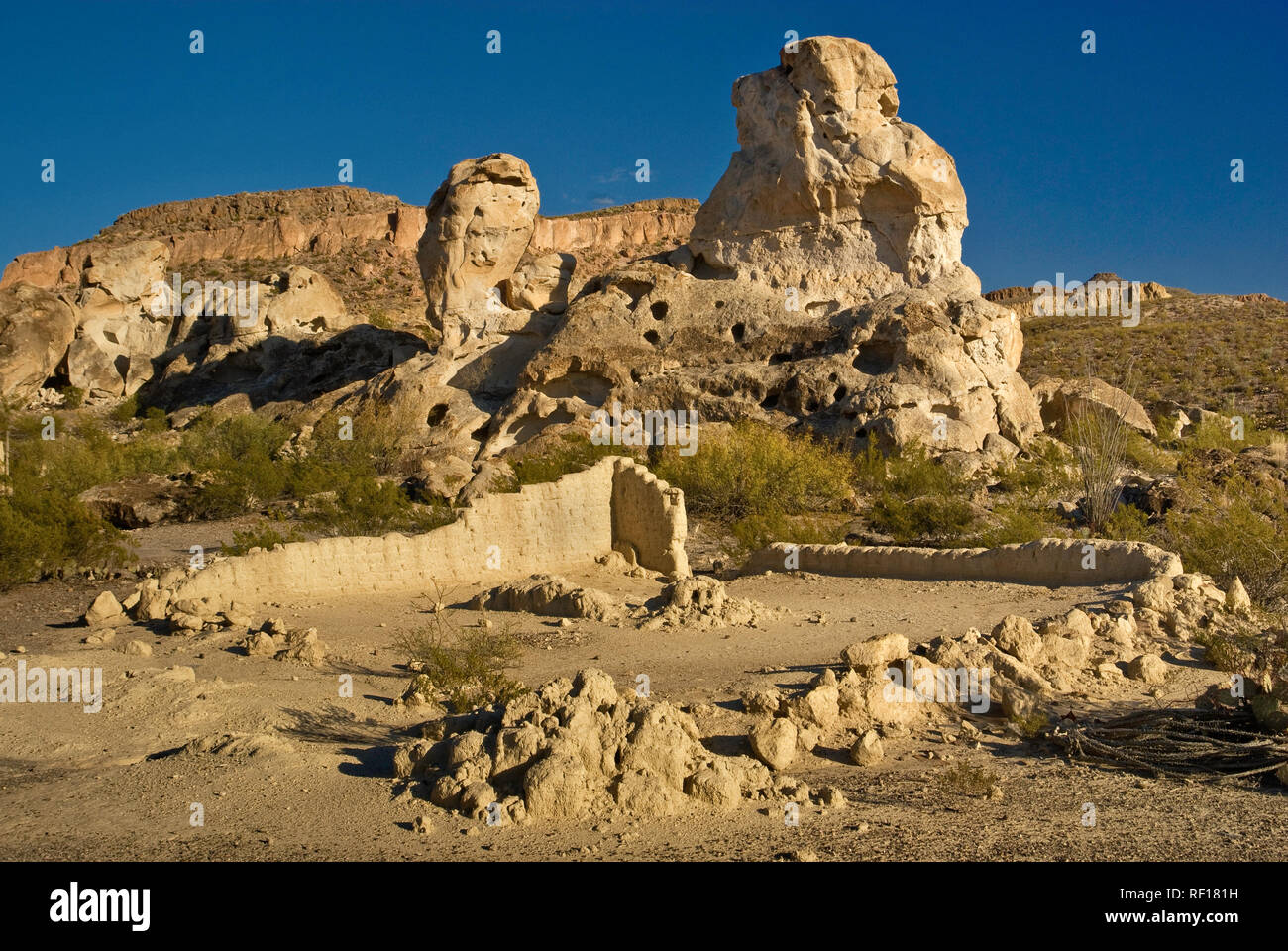 Ruins of adobe houses near abandoned mines in Three Dike Hill area in Bofecillos Mountains, Chihuahuan Desert, in Big Bend Ranch State Park, Texas USA - Stock Image