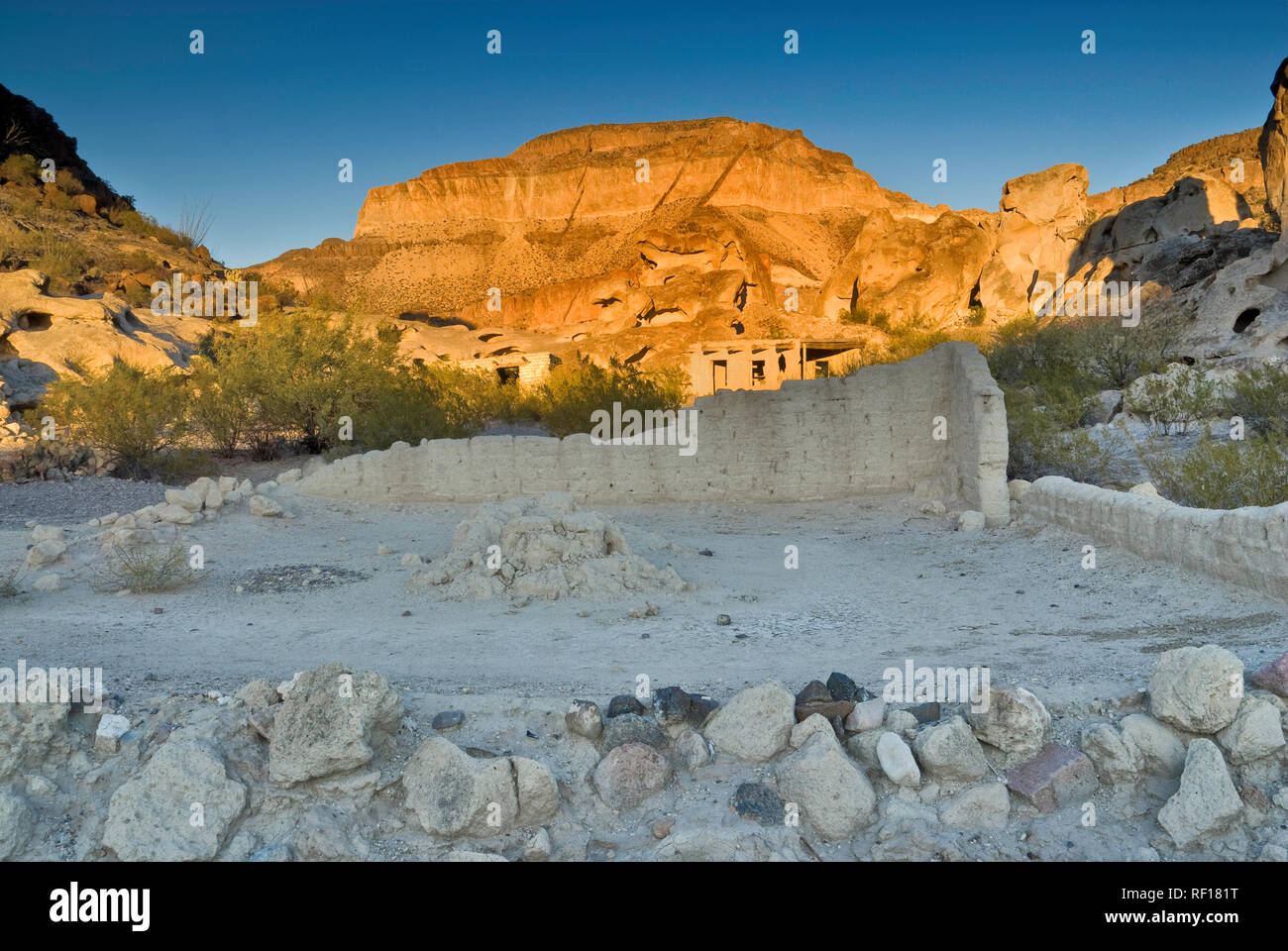 Ruins of adobe houses near abandoned mines in Three Dike Hill area in Bofecillos Mountains, Chihuahuan Desert, Big Bend Ranch State Park, Texas, USA - Stock Image