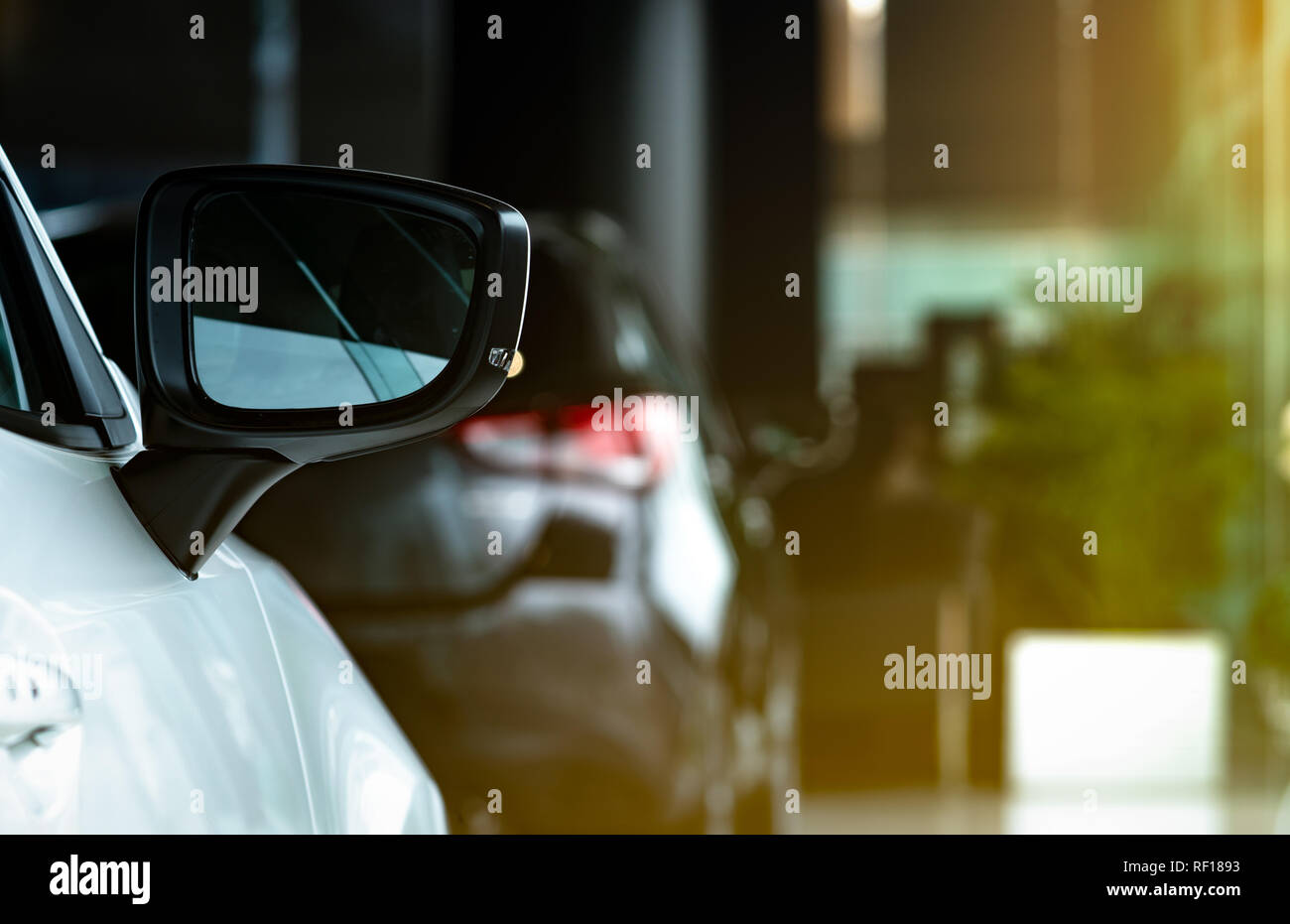New luxury SUV compact car parked in modern showroom. Car dealership office. Car retail shop. Electric and hybrid car technology. Automobile rental co - Stock Image