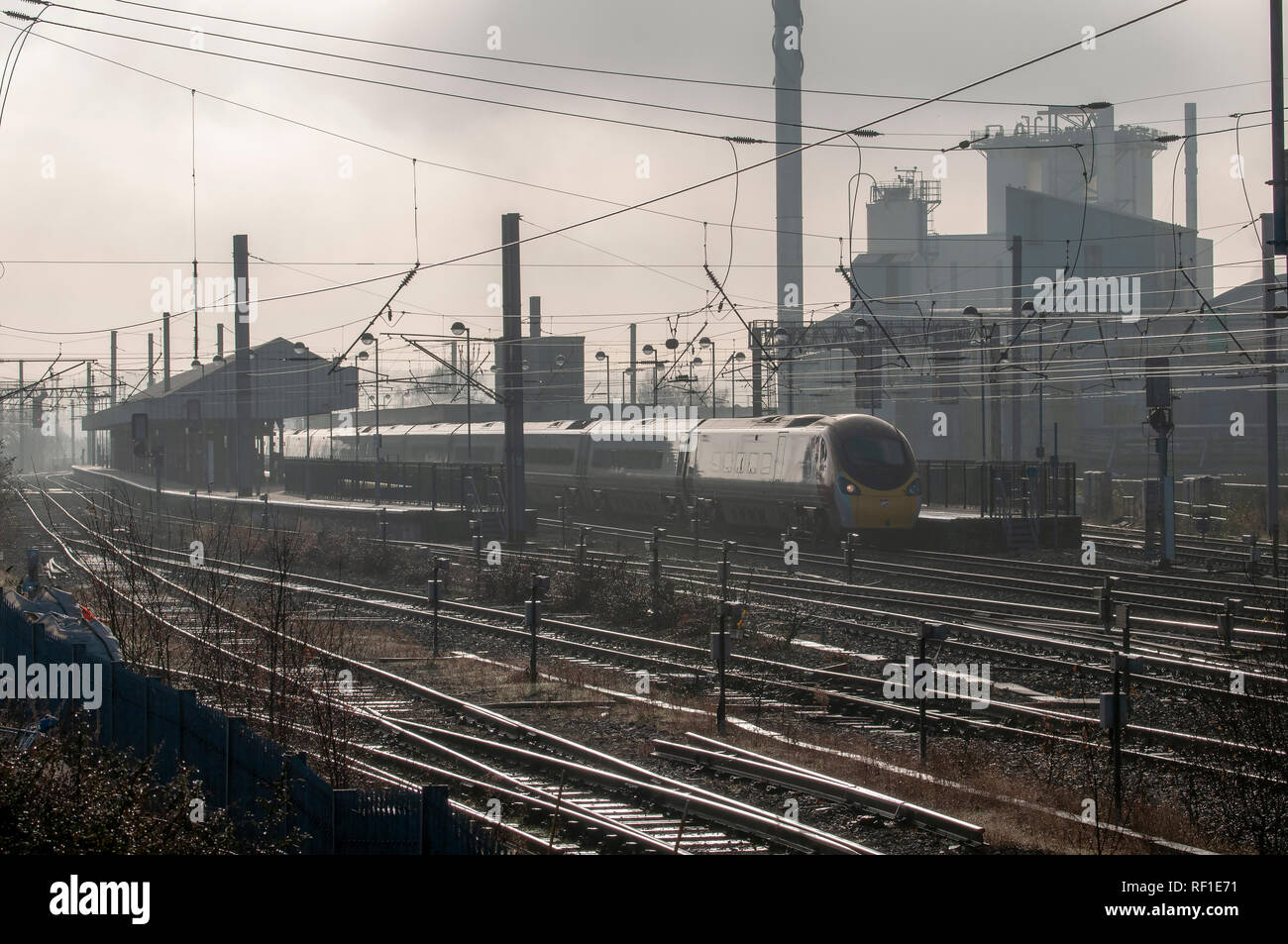 Misty Bank Quay station with Unilever factory in background. Stock Photo
