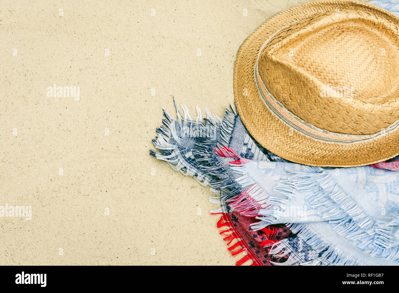 61105a9e Vintage summer wicker straw beach hat and blue pareo on the seashore of  Catania, Sicily