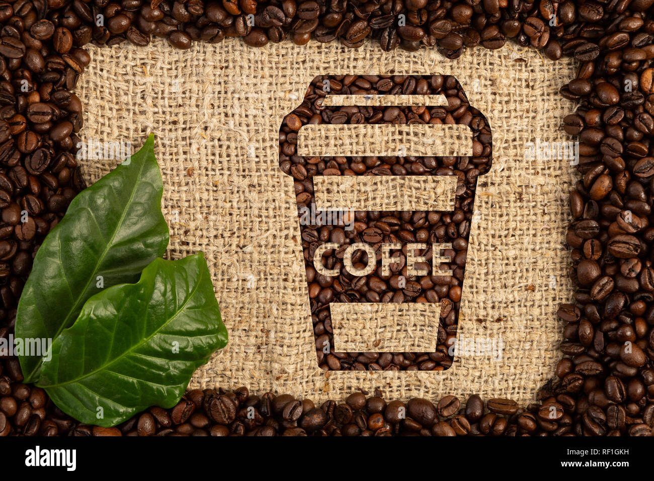 Carton cup for coffee to-go with text written on it on brown burlap bean bag background Stock Photo