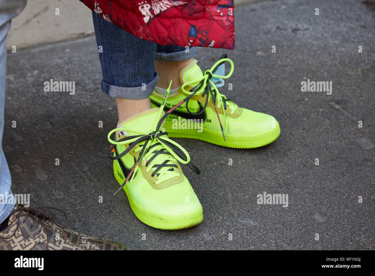 info for 06c1a 68e51 MILAN, ITALY - JANUARY 13, 2019: Woman with yellow Nike Air ...