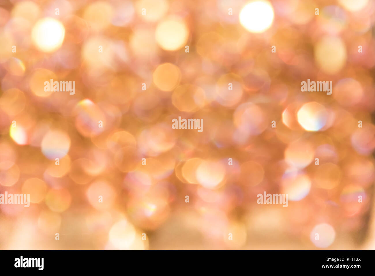 Bokeh blur fairy texture of pearls and diamonds shimmering in the light. - Stock Image