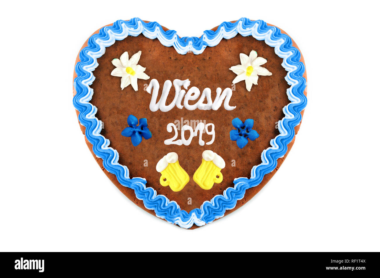 Oktoberfest 2019 Gingerbread heart with white isolated background. October festival is a seasonal beer event in Munich (Germany). Traditional heart ca Stock Photo