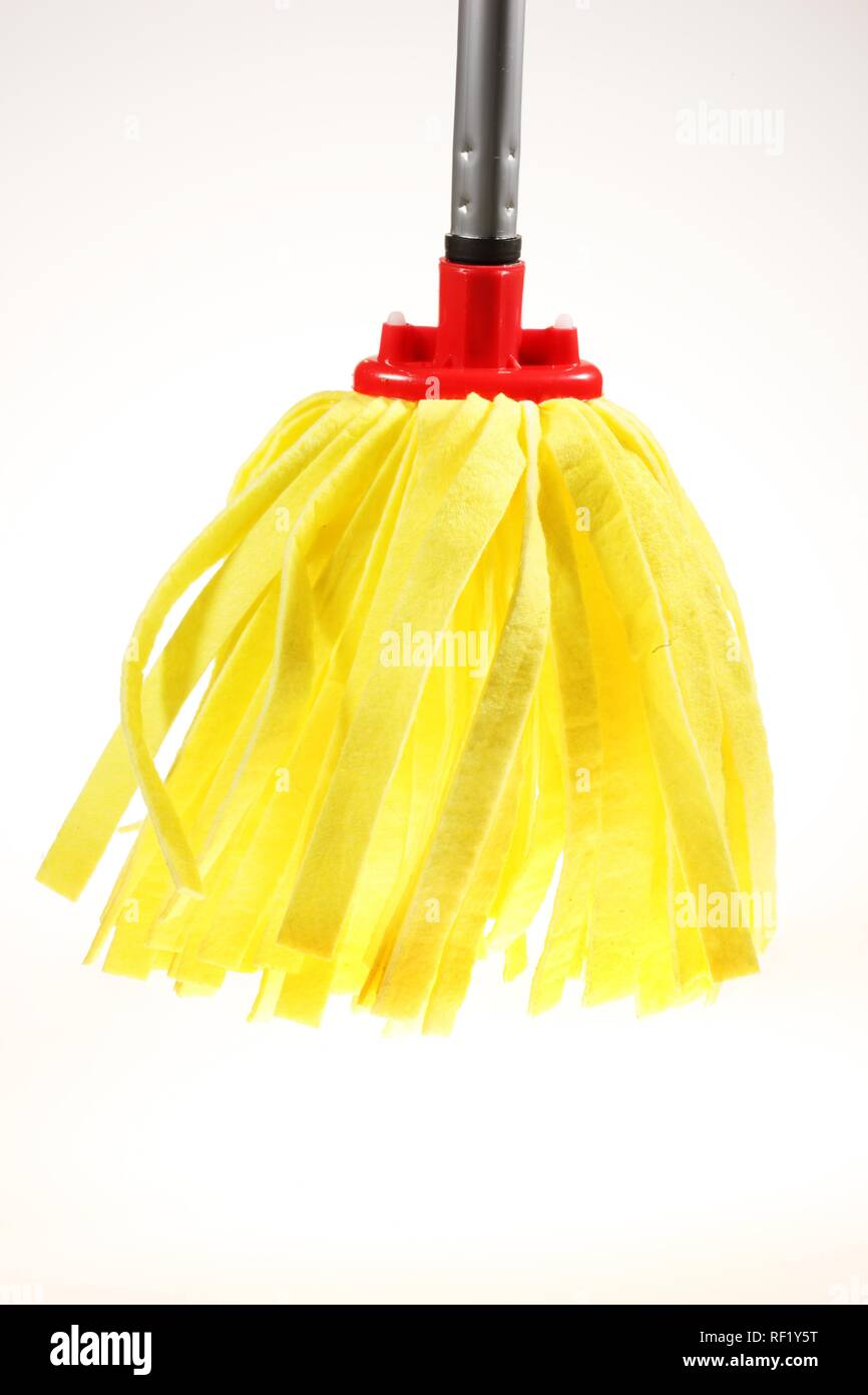 Yellow mop used to mop floors - Stock Image