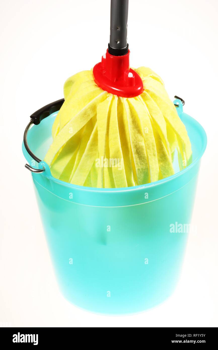 Yellow mop and bucket used to mop floors - Stock Image
