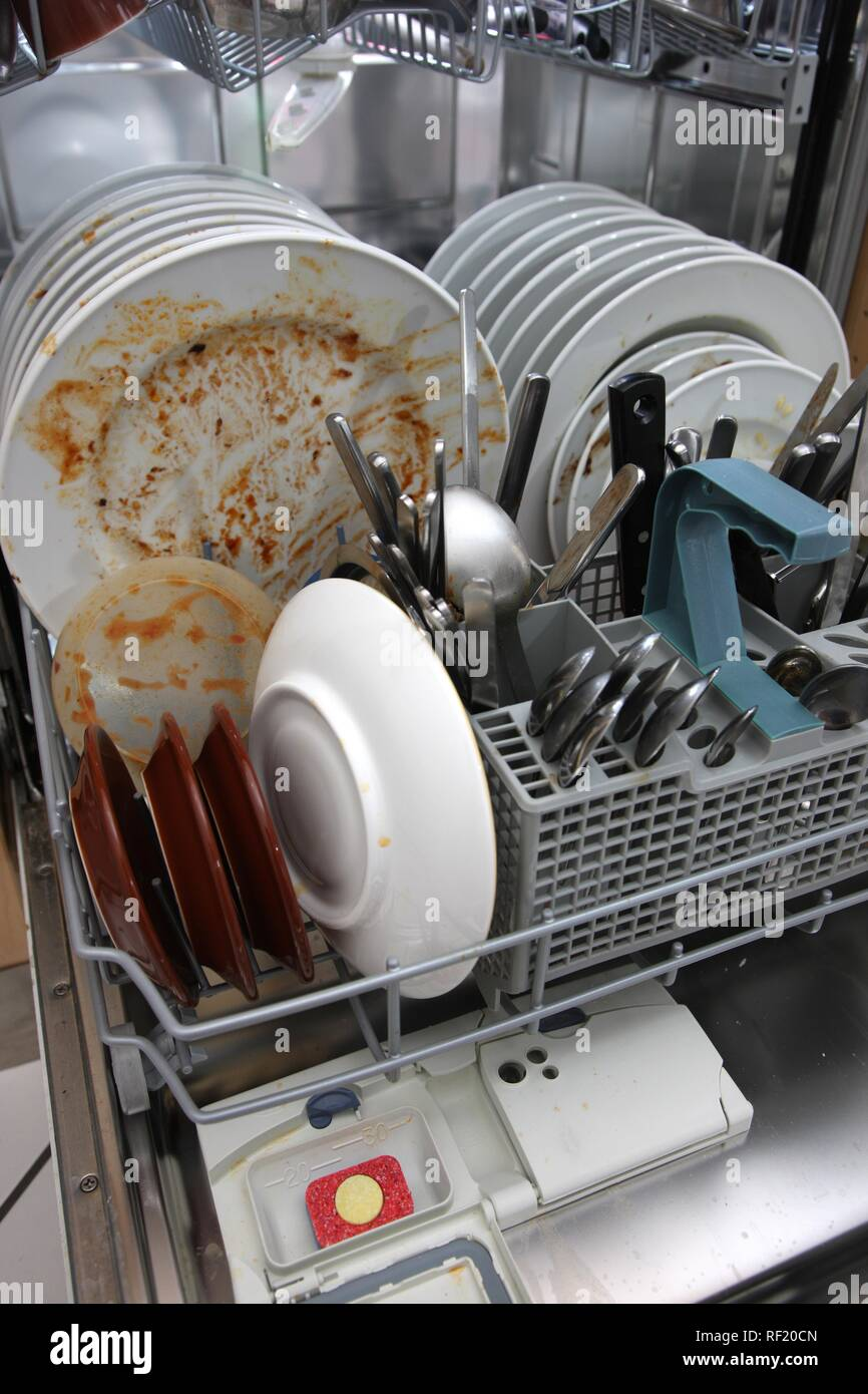 Dishwasher full of dirty dishes Stock Photo: 232998885 - Alamy