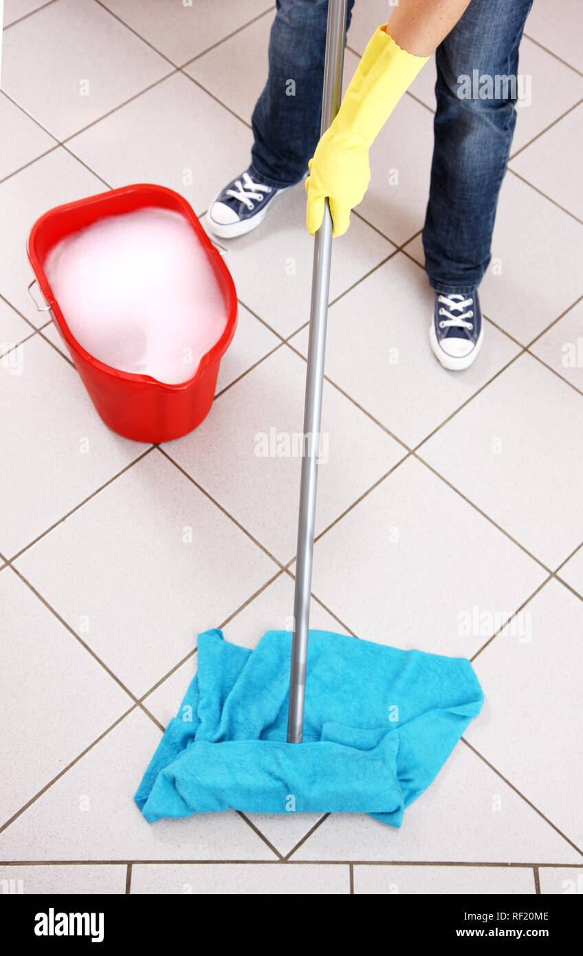 House work, cleaning, wiping floor with damp cloth - Stock Image