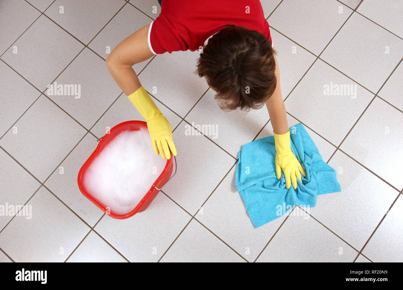 House work, woman cleaning, wiping floor with damp cloth - Stock Image
